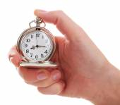Silver pocket clock in hand isolated on white — Stock Photo