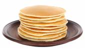 Stack of delicious pancakes on plate isolated on white — Stock Photo