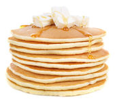 Stack of delicious pancakes with butter and honey isolated on white — Stock Photo