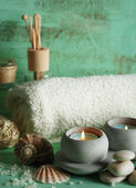 Candles, towel, sea salt and spa stones on wooden background — Foto de Stock