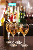 Glasses of wine on counter and bar on background — Stock Photo