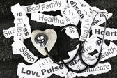 Decorative heart  with stethoscope on background of paper notes — Stock Photo