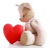 Teddy Bear with red heart isolated on white — Stock Photo
