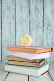 Books with flower on wooden background — Stock Photo