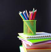 School supplies on black background — Stock Photo