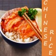 Bowl of rice with salmon and space for your text on bamboo mat background — Stock Photo #62772095