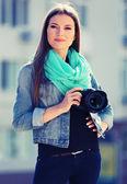 Young photographer taking photos outdoors — Stock Photo