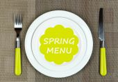 Plate with text Spring Menu, fork and knife on tablecloth background — Stock Photo