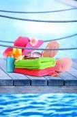 Bright beach accessories on sea background — Stock Photo