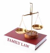 Scale on FAMILY LAW book isolated on white — Stock Photo