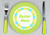 """Plate with text """"Easter Menu"""", fork and knife on gray background — Foto de Stock"""