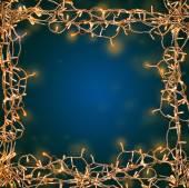 Christmas lights as festive frame on bright blue background — Stock Photo