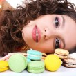 Young girl with tasty macaroons — Stock Photo #62835769