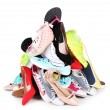 Pile of various female shoes isolated on white — Stock Photo #62839823