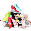 Pile of various female shoes isolated on white — Stock Photo #62839829