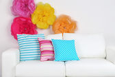 Sofa with colorful pillows — Stock Photo