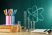 Desk in chemistry class with test tubes — Stock Photo