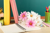 Composition on desk with books and flowers — Stock Photo
