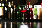 Glass of wine with bar — Stock Photo