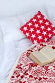 Book on bed — Stock Photo