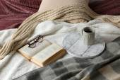 Book, glasses and cup  on bed — Stockfoto