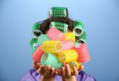Girl in hair curlers — Stock Photo