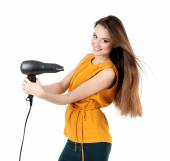 Beautiful young woman with long hair holding hair dryer isolated on white — Stock Photo