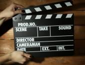 Movie clapper in female hand — Stock Photo