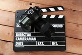 Photo camera and movie clapper — Stock Photo