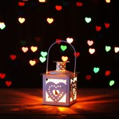 Lantern on background with hearts — Stock Photo