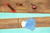 Carpenter tools on new laminate floor — Stock Photo