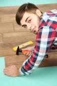 Carpenter worker installing laminate flooring in the room — Stock Photo