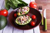 Tasty salad in avocado on plate table close-up — Stock Photo