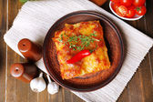 Portion of tasty lasagna on table — Stock Photo