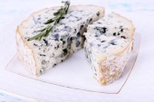 Blue cheese with sprigs — Stock Photo
