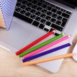 Laptop with computer mouse and colorful pencils on wooden table background — Stock Photo #62952533