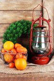 Kerosene lamp with wreath — Stock Photo