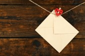 Love letter hanging on rope — Stock Photo
