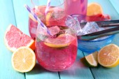 Pink lemonade in glasses on table close-up — Stock Photo