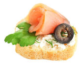 Canape salmon, black olive and herbs  on bread slice isolated on white — Stock Photo