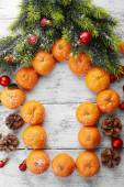Christmas composition with tangerines on wooden background — 图库照片