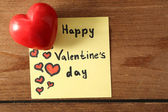 Valentines day note on wooden background — Stock Photo
