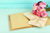 Old letters and book with flowers on wooden background — Stock Photo