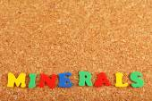 Minerals word on cork board background — Stock Photo