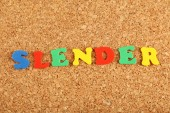 Slender word on cork board background — Stock Photo