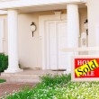 Sold home for sale Real estate sign in front of new house — Stock Photo #62969077
