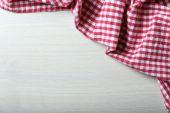 Napkin on wooden table — Stock Photo