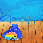 Bright beach accessories on pool background — Stock Photo