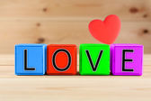 Love spelled in color wooden blocks — Zdjęcie stockowe