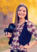 Young photographer taking photos outdoors — Stock Photo